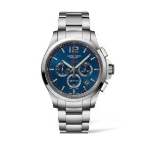 Heren horloge uit de Conquest VHP collection - uitgevoerd met een blauwe wijzerplaat en een stalen kast en band - voorzien van een Very High Precision Quartz uurwerk met chronograph functie - De Longines collectie is verkrijgbaar bij Sparnaaij Juweliers in Aalsmeer